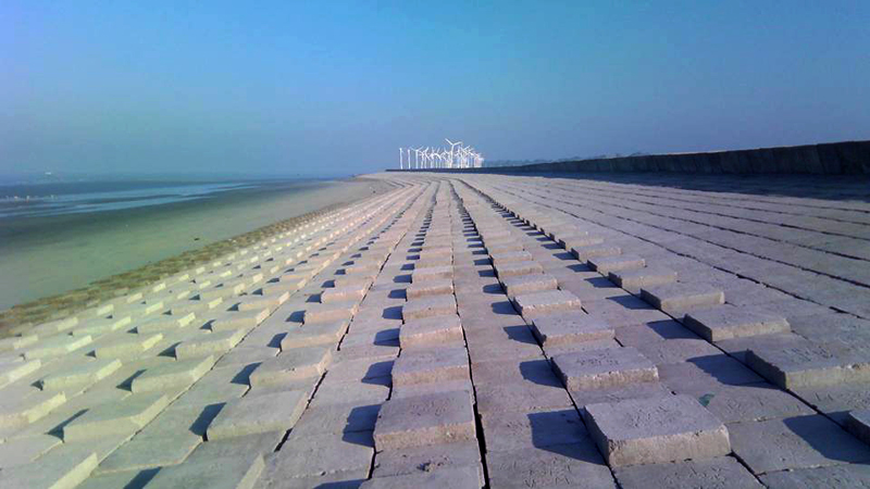 Construction of embankment with slop protection in Kutubdia, Cox's Bazar, Bangladesh.